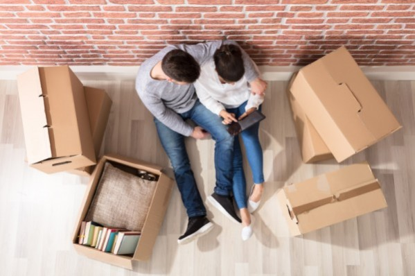 couple surround by boxes